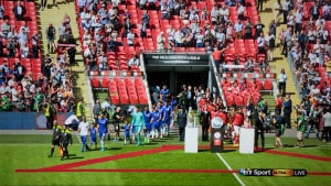 Teams coming onto the pitch