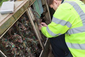 Engineer fixing a broadband fault