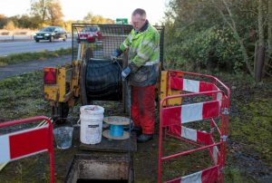 Openreach engineer laying fibre-optic cable
